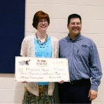 NWTF's Shawn Dickey presents Mallory Spring with the $10,000 NWTF National Scholarship sponsored by Mossy Oak.
