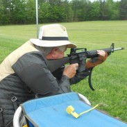 The author shoots sitting rapid fire during the Small Arms Firing School at the Eastern CMP Games. Rifles are issued on the line minutes before the match begins.