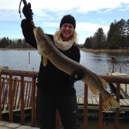 Katie Pieper holds the trophy northern pike that she and Katie Berg took during the transitional time of ice-in and ice-out on Lake of the Woods.