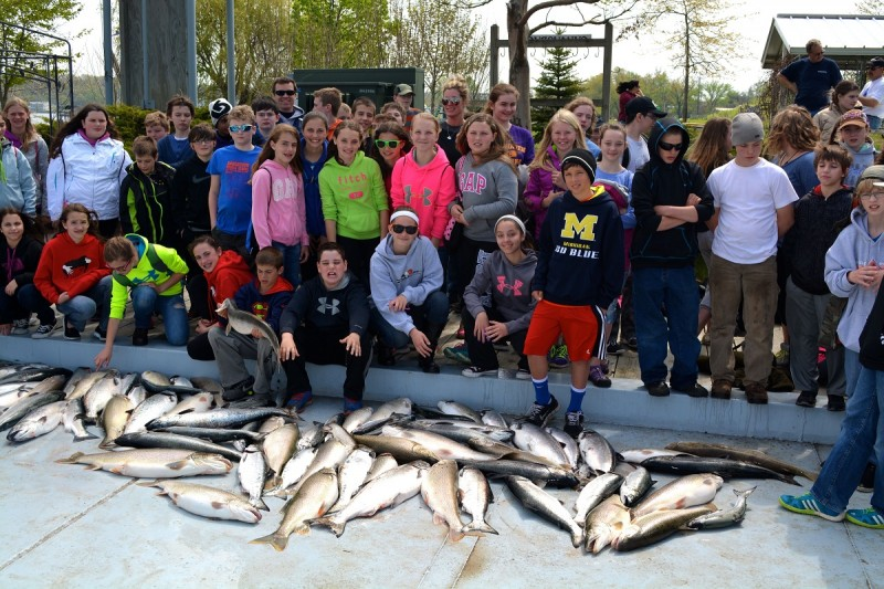 The Lake Michigan fish were biting Tuesday out of Saugatuck as approximately 65 middle-schoolers on 19 boats landed more than 80 salmon and trout in about three hours of trolling.