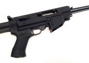 The receiver housing serves as the mounting point for pistol grip and adjustable stock.