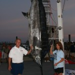 Deb Hebert's 843.7-pound marlin, caught during the Mississippi Gulf Coast Billfish Classic. Joe Hudson, owner of the Iona Louise, stands to the left.