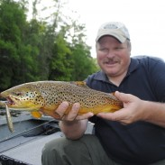 Denny Bouwens shows off a nice brown trout taken on a Rapala.