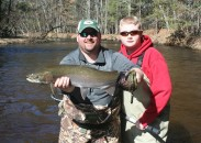 Guide Josh Mead caught this nice rainbow while fishing with his son Brandon on the Pere Marquette River in Baldwin, Michigan.