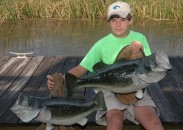Although Linder held the big bass by one hand on the shore, it took two hands to pull the giant into the boat.