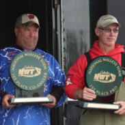 First-place co-angler Tyrone Larson (left) and first-place pro-angler Wade While (right) pose with their respective trophies at the Cabela's National Walleye Tour event at Mobridge, S.D. on June 29.