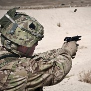US Army Staff Sgt. Todd A. Christopherson fires a Beretta M9, which the Army seeks to replace with a more efficient, accurate weapon.