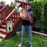 James VanArsdall holds up his hefty fish at a weigh station.