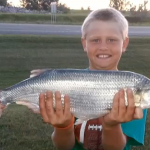 Brayden Selzler holds up a behemoth of a goldeye, which normally average under one pound in weight.