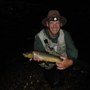 Tom Goniea shows off an Au Sable River brown trout.