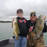 Wyatt and Chris Noffsinger show off their smallmouths from Chris' day-off fishing trip on the waters of the Grand Traverse Bay.
