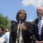 Congresswoman Robin Kelly (center) standing beside Illinois Governor Pat Quinn (right).