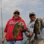 Greg Sochocki, left, and Jaime Ayala compare Saginaw Bay smallmouth bass.