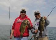 Greg Sochocki, left, and Jaime Ayala compare Saginaw Bay smallmouth bass.