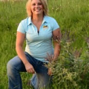 Kelsi Wehrman takes position to promote partnership between Pheasants Forever and Nebraska Game and Parks Commission.