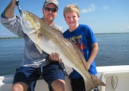 Youngsters can hook and reel in giant redfish like this one, but parents usually have to help get the reds in the boat.