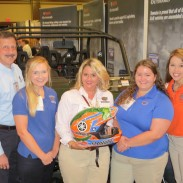 Dr. Ricky Telg, Jessica Holt, Andrea Davis, Caroline Roper and Tiffany Dale from the The University of Florida ACT Chapter display the custom-painted helmet provided by Yamaha.
