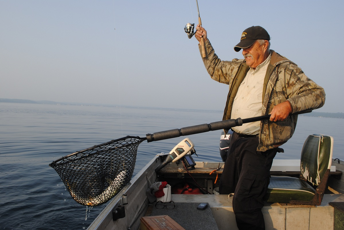 The early bird gets the lake trout on grand traverse bay for Scotts flat lake fishing