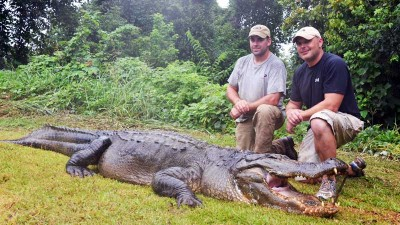 Jay Leggette (left) and Robert Mahaffey with their 756-pound Mississippi state record alligator. It was overtaken by an even bigger specimen just a few days later.