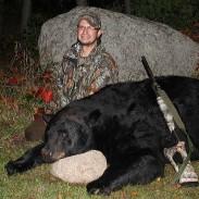 Dennis Arndt of Manawa, Wisconsin with the monster 780-pound black bear he shot Sunday, September 21, near Ogdensburg.