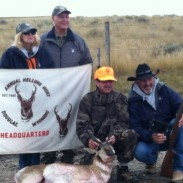 Visually impaired hunter Ben Frezza with his Helluva Hunt goat, Gary Stearns holding the double scope, with Jane Stearns and Ron Coburn of Savage Arms.