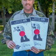 Brian Sloan poses with his targets from the 20-Gauge Open Division finals at the NWTF World Still Target Champsionships.