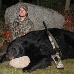 Dennis Arndt of Manawa, Wisconsin with the monster 780-pound black bear he shot Sunday, September 21, near Ogdensburg.