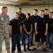Rossi Morreale visits a high school JROTC air rifle team.