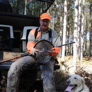 Paul Zeman poses with his grouse and Zoey.