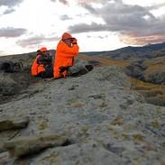 Jim Simonson, foreground, and Leah Durkin study the Colorado mountainside.