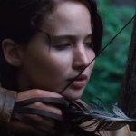 Jennifer Lawrence as Katniss focusing on a deer hunt. Screenshot of video from mediaaccess from YouTube.