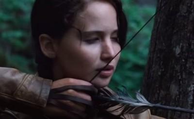 Jennifer Lawrence as Katniss focusing on a deer hunt. Screenshot of video from mediaaccess from YouTube.