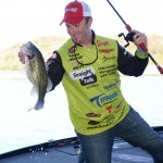 Scott Canterbury, pictured here, fishes the Punisher buzzbait any time the water is 50 degrees or above.