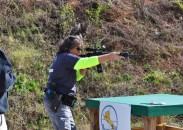 Julie Waasted shoots her rifle left-handed in a 3-gun competition. Originally right-handed, complications from brain surgery forced Julie to change how she lived her life and how she shot. Image by Michelle Cerino.