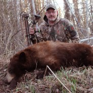 The cinnamon-colored bear the author shot in 2014 during a spring hunt in Saskatchewan gave him three of the four color phases. His quest to become one of the first hunters to take all four major colors with a bow is now three-quarters of the way complete.