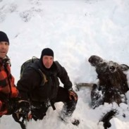 Rob Uphus (far left) and Marty Mobley (center) briefly paused for a picture with this buried moose before they freed it.