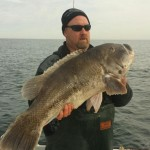 Kenneth Westerfeld of College Point, New York holding a nearly 29-pound tautog.