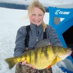 Tia Wiese holds up her new world ice fishing record for yellow perch.