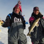 Ice Team Pro Staffers Barb Carey and Shelly Holland catch walleyes on Lake of the Woods. Image by Keith Worrall.