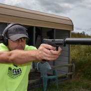 Matt Ohrstrom shoots an HK VP9 with a suppressor. Image by Matt Korovesis.