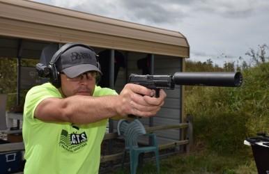 Matt Ohrstrom shoots an HK VP9 with a suppressor. Image by Matt Korovesis.