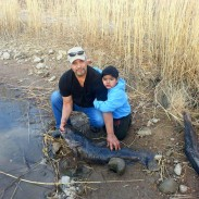 La Junta angler Tony Chavez (left) shows off his state record catfish.