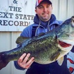Gabe Keen proudly holds up his new state record largemouth.