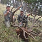 Albert Henderson (right) smiles over his world record bull elk alongside hunting buddy Larry Michaels (left).