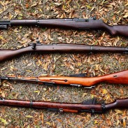 If you're a military surplus gun collector, there are some guns you just have to own. From top to bottom in this photo: M1 Garand, M1903 Springfield, M44 Mosin-Nagant, and Lee-Enfield No. 1 MK III. Image by Jim Grant.