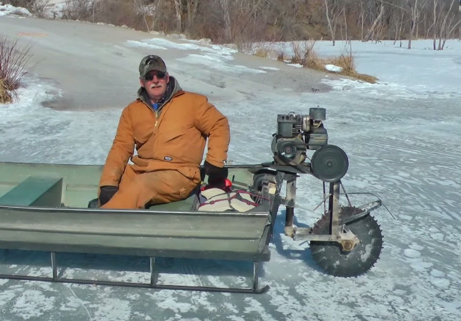 Video man uses saw blade old jon boat as motorized ice for Ice fishing snowmobile