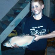 Austin Stoll holds up his first, but possibly not last, state record fish.