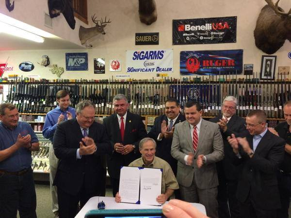 Governor Abbott signs open carry into law at a Pflugerville gun shop.