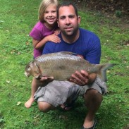 Hardy Dam Lake must be full of huge carpsuckers, because this bowfisherman pulled out another after the previous record was harvested there in June. Here Blake Wilson poses with the fish and his daughter Brylee.