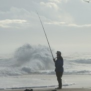 Waves and current this strong require a tough line and a heavy sinker to keep the bait out in the current.